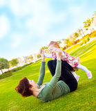Mother and baby girl playing outdoor Stock Photo