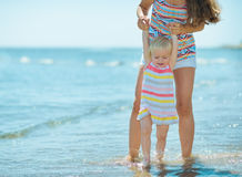 Mother and baby girl playing at seaside Royalty Free Stock Photos