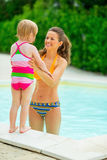 Mother and baby girl at poolside Royalty Free Stock Images