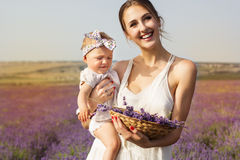 Mother with baby girl in purple lavender field Royalty Free Stock Photography