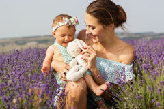 Mother with baby girl in purple lavender field Stock Photography