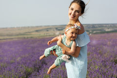 Mother with baby girl in purple lavender field Stock Image