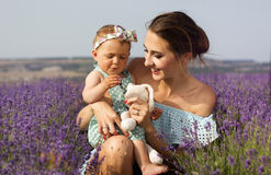 Mother with baby girl in purple lavender field Royalty Free Stock Photos