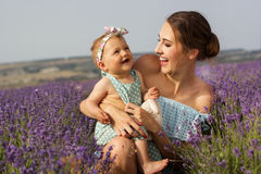 Mother with baby girl in purple lavender field Royalty Free Stock Images