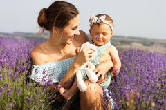 Mother with baby girl in purple lavender field Stock Photo