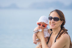 Mother and baby girl at sea Royalty Free Stock Image