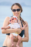 Mother and baby girl at sea Stock Photo