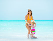 Mother and baby girl at seaside Royalty Free Stock Image