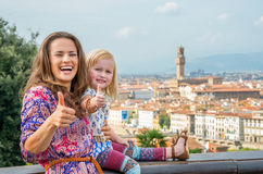 Mother and baby girl showing thumbs up in florence Stock Images