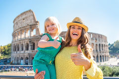 Mother and baby girl showing thumbs up in rome stock photography