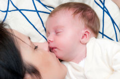 Mother and baby girl sleep Stock Image