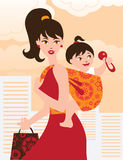 Mother with baby girl in a sling. Active mother with baby girl in a sling Royalty Free Stock Photography