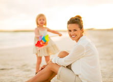 Mother and baby girl spending time on the beach Royalty Free Stock Image