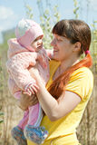 Mother with   baby girl in spring Stock Photo