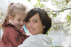Mother and baby girl in spring garden Stock Photo