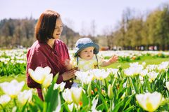 Mother and baby girl in spring park stock photo