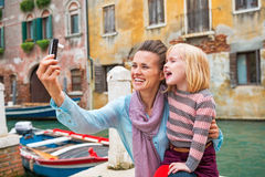 Mother and baby girl taking photo while in venice Royalty Free Stock Image
