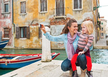 Mother and baby girl taking photo in venice Stock Image