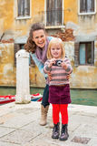 Mother and baby girl taking photo in venice Royalty Free Stock Photo