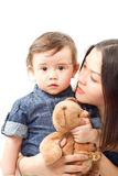 Mother and baby girl with toy Teddy bear Stock Photo