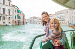 Mother and baby girl travel by venice water bus Stock Images