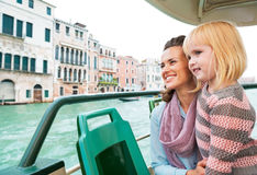 Mother and baby girl travel by venice water bus Royalty Free Stock Images