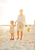 Mother and baby girl walking on beach Royalty Free Stock Photo