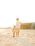 Mother and baby girl walking on beach Royalty Free Stock Images