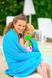 Mother and baby girl wrapped in towel Royalty Free Stock Photo