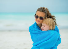 Mother and baby girl wrapped in towel Stock Image