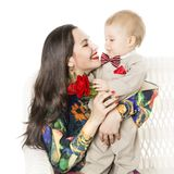 Mother and Baby Gives Flower Bouquet Gift, Happy Mom and Son Boy. Mother and Baby Gives Flower Bouquet Gift, Happy Mom with her Son Boy, Well dressed family with Stock Photo