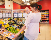 Mother and Baby in Grocery Store Stock Photos