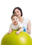 Mother with baby on gymnastic ball. Mother with baby having fun with gymnastic ball Stock Photography