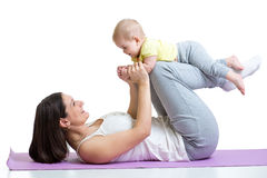 Mother and baby gymnastics, yoga exercises Stock Images
