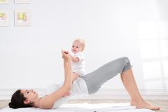 Mother and baby gymnastics Royalty Free Stock Photos