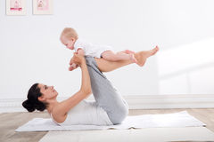Mother and baby gymnastics Stock Image