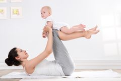 Mother and baby gymnastics Royalty Free Stock Image