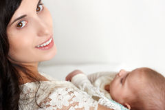 Mother with baby on hand portrait, happy maternity concept Stock Image