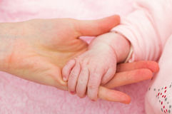 Mother and baby hands Stock Photos