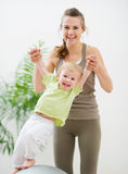 Mother and baby having fun in gym Stock Photography