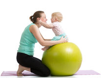 Mother with baby having fun gymnastic. Mother with baby having fun with  gymnastic ball Royalty Free Stock Photography
