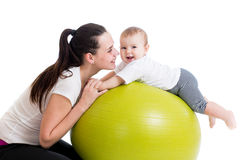 Mother and baby having fun with gymnastic ball. Mother and baby do fitness Royalty Free Stock Image