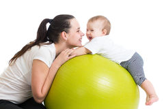 Mother and baby having fun. Mother and her baby having fun on gymnastic ball Royalty Free Stock Photo