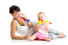 Mother and baby having fun with musical toys Royalty Free Stock Images