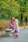 Mother and baby having fun time in city park Royalty Free Stock Photography
