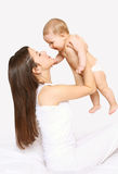 Mother and baby having fun together, mom playing with infant Royalty Free Stock Image