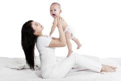 Mother and baby having fun together Stock Images