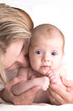 Mother and baby in her arm royalty free stock images