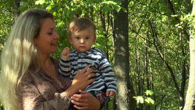 Mother with baby in her arms stock video footage