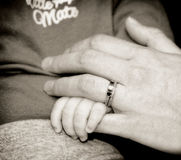 Mother and baby hold hands Royalty Free Stock Photos